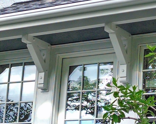 Painted heavy timber brackets & braces